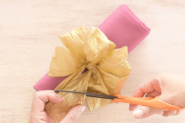 Step 10: Pop-up the loops and shape the bow. Cut the ends at the desired length.