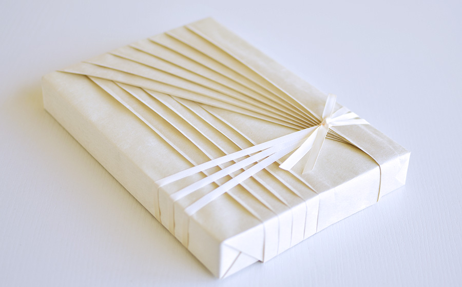 Gift wrapping design created with handmade Washi paper.
