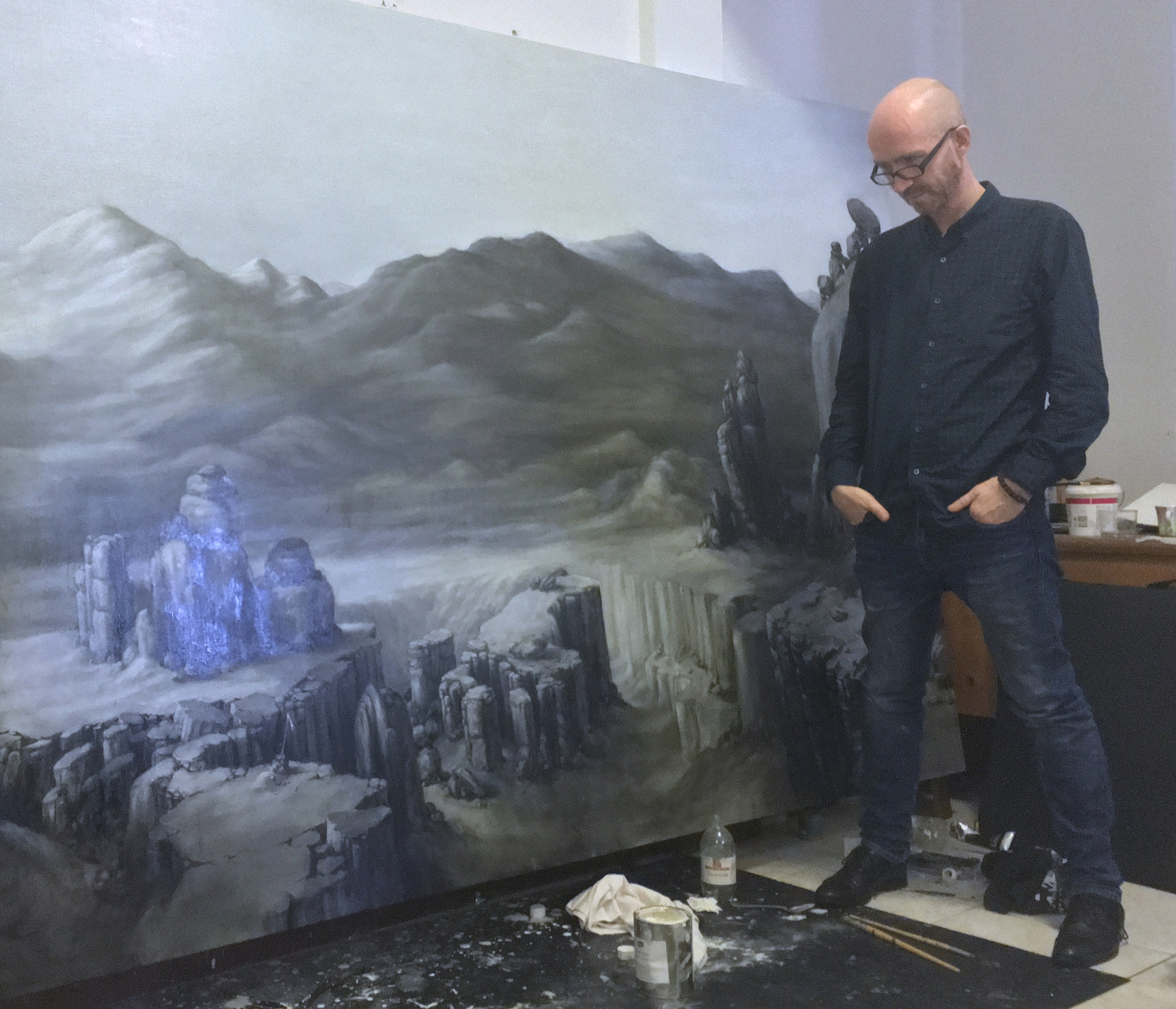 Artist Martin Constable in front of his latest painting (detail) in his studio at Nanyang Terrace, Singapore.
