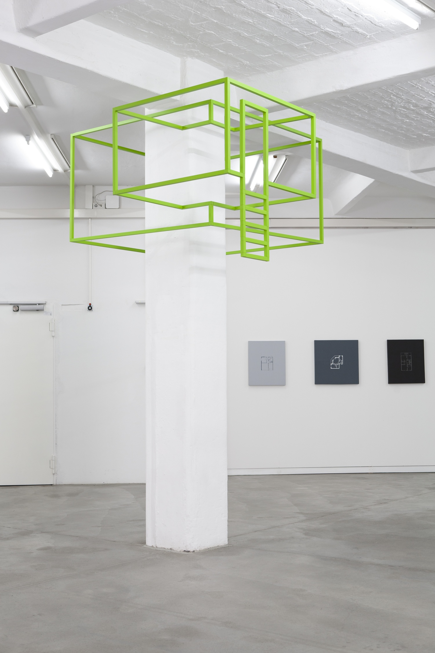 """Installation view at """"Some Detours: Michael Lee"""", 2013,Künstlerhaus Bethanien, Berlin, Germany: AROUND PILLAR: Michael Lee, Skeletal Retreat No. 1, 2013, emulsion and aluminium hollow section, 125 x 230 x 235 cm, Ed. 1 / 3 + 1 AP; ON WALL: Michael Lee, selections from the series """"Dwelling"""", 2013, acrylic on canvas, various dimensions, photos by Ute Klein."""