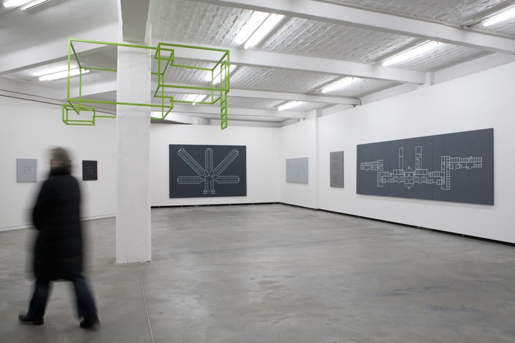 """Installation view at """"Some Detours: Michael Lee"""", at Künstlerhaus Bethanien, Berlin, Germany, 2013:ON PILLAR: Michael Lee, Skeletal Retreat No. 1 , 2013, emulsion on aluminium and plastic,125 x 230 x 235 cm.ON WALL: Michael Lee, selections from the series """"Dwelling"""", 2013, acrylic on canvas, various sizes on 1:50 scale.Künstlerhaus Bethanien, Berlin, Germany, photo by Ute Klein."""