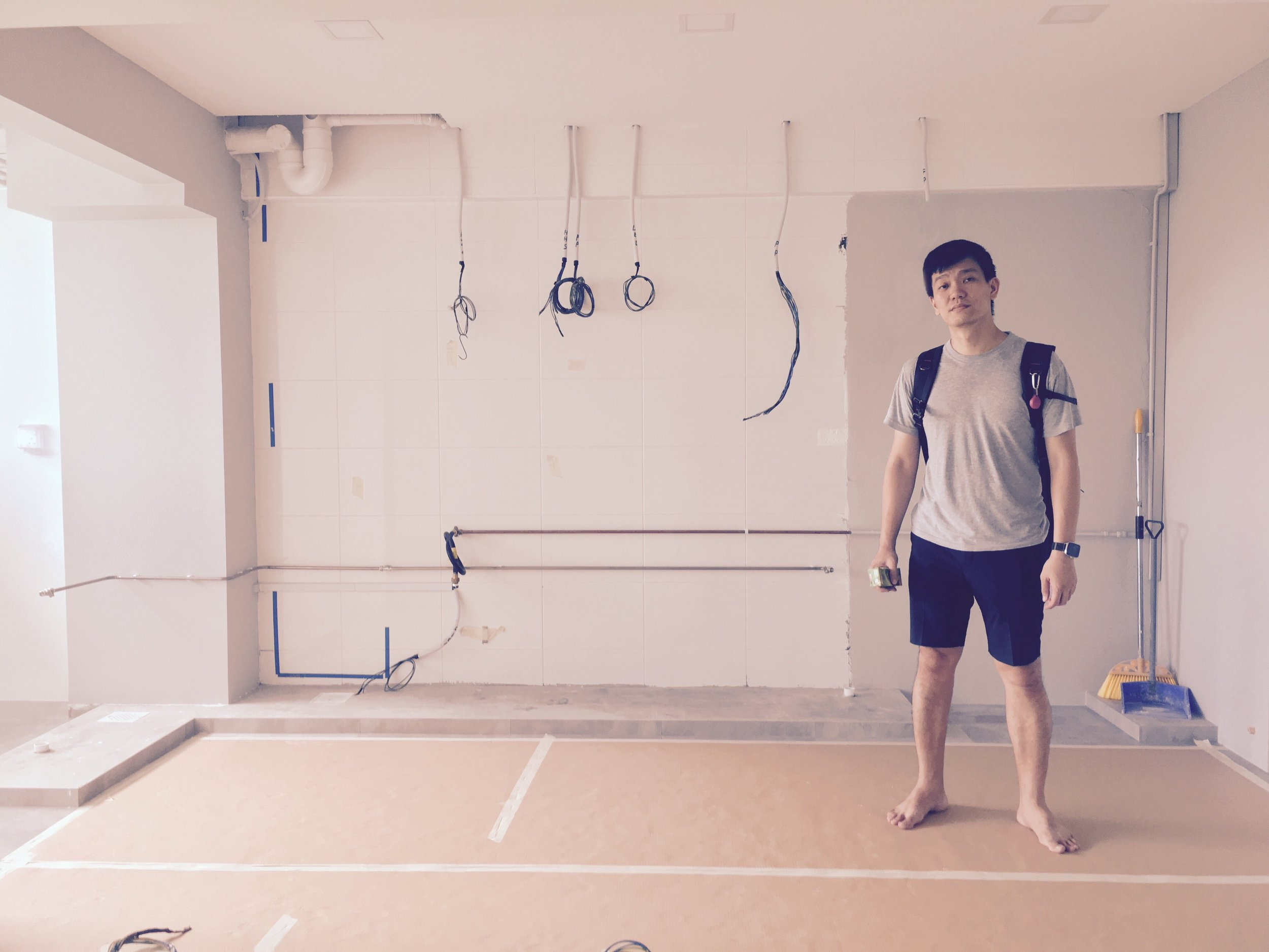 Lee Sze-Chin in the kitchen area of his HDB flat at Sengkang, which he was renovating into a home-cum-community-arts-space. Photo by Michael Lee, 2017.
