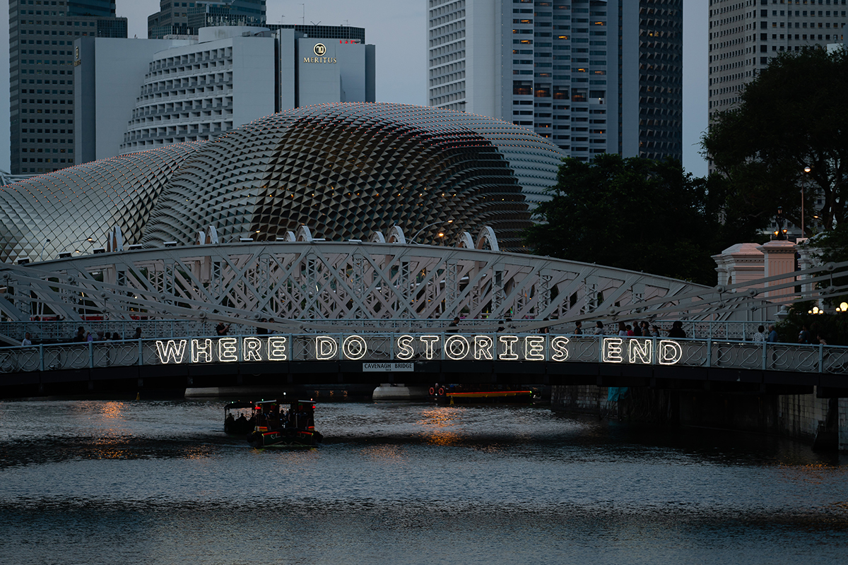 "Michael Lee and Perception3,  Where do stories begin / Where do stories end  (detail), 2019, LED neon rope mounted on acrylic sheets installed on railings of Cavenagh Bridge, Singapore, part of ""Bridges of Time"": i Light 2019 Bicentennial Edition. Photo by Supergrapher."