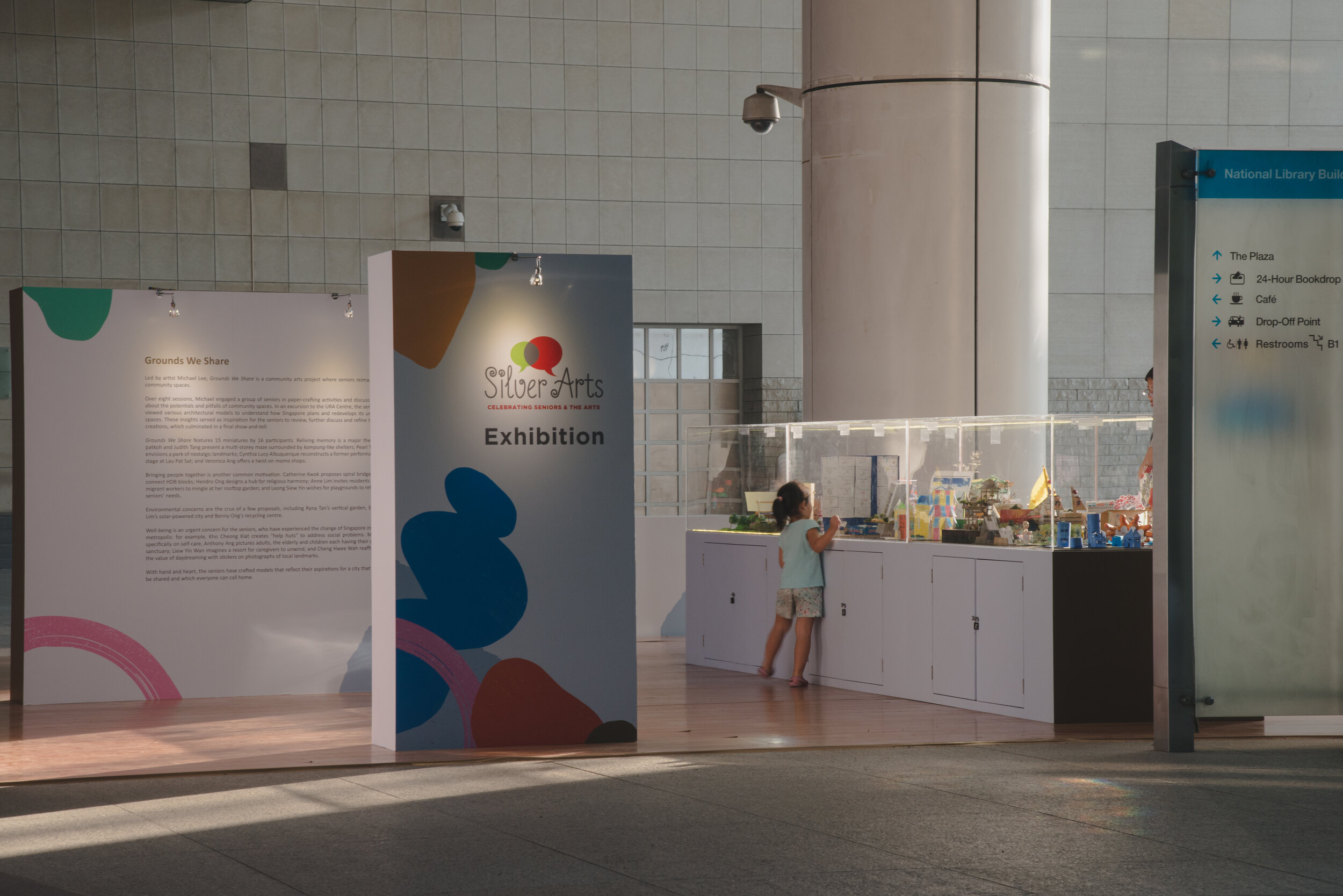 """Installation view (from Middle Road) of """"Grounds We Share"""" at The Plaza, National Library Building, Singapore, a community arts project of Silver Arts 2019, led by artist Michael Lee with 16 participants. Photo by Ng Hui Hsien."""