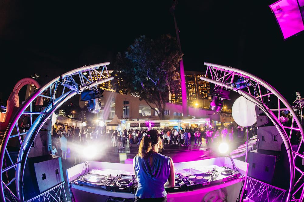 DJ Yummy spinning tracks at STAR ISLAND.jpg