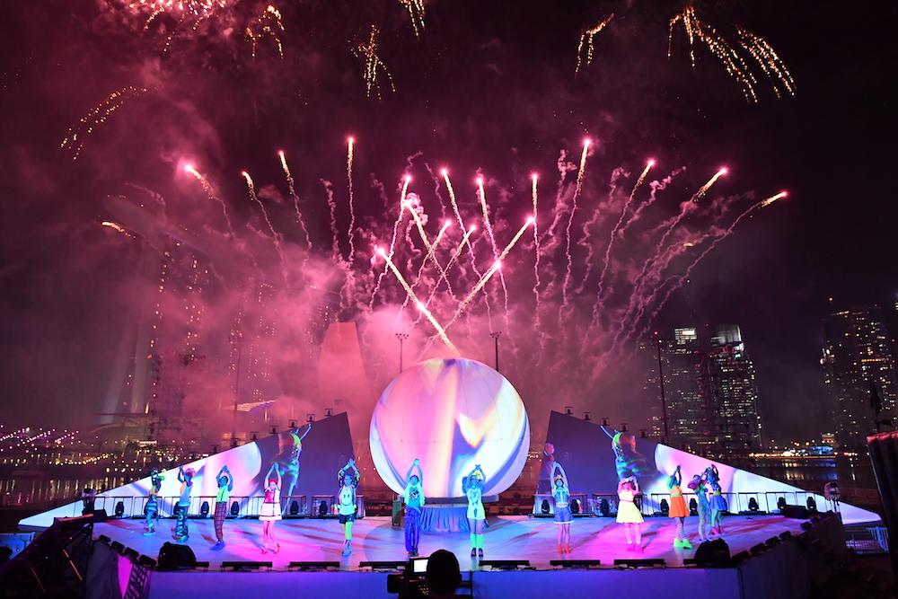 Dancers amid fireworks at STAR ISLAND.JPG