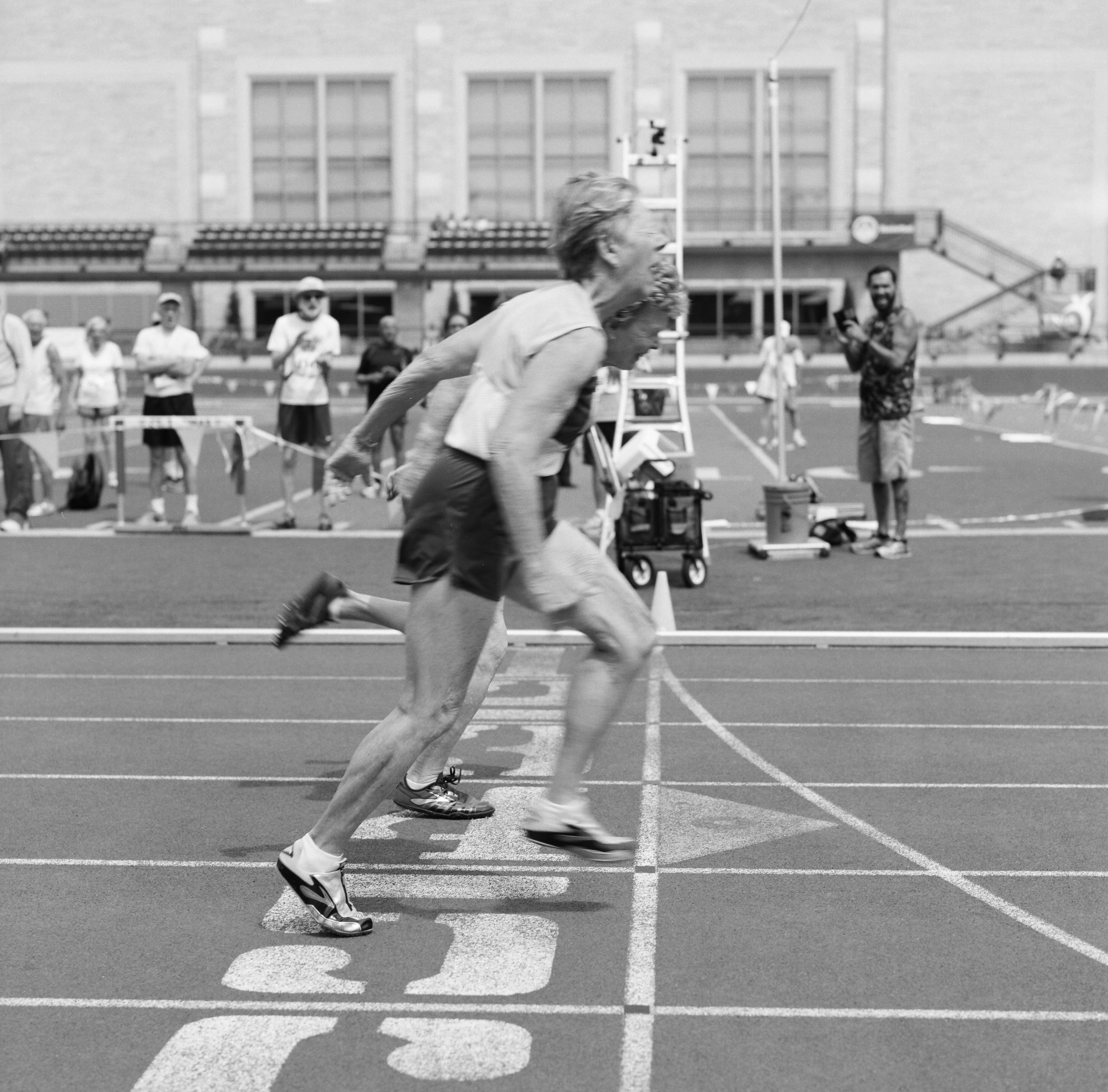 Flo & Barbara. Women's 80-84 100 meter finish line. National Senior Games. Minneapolis, 2015.