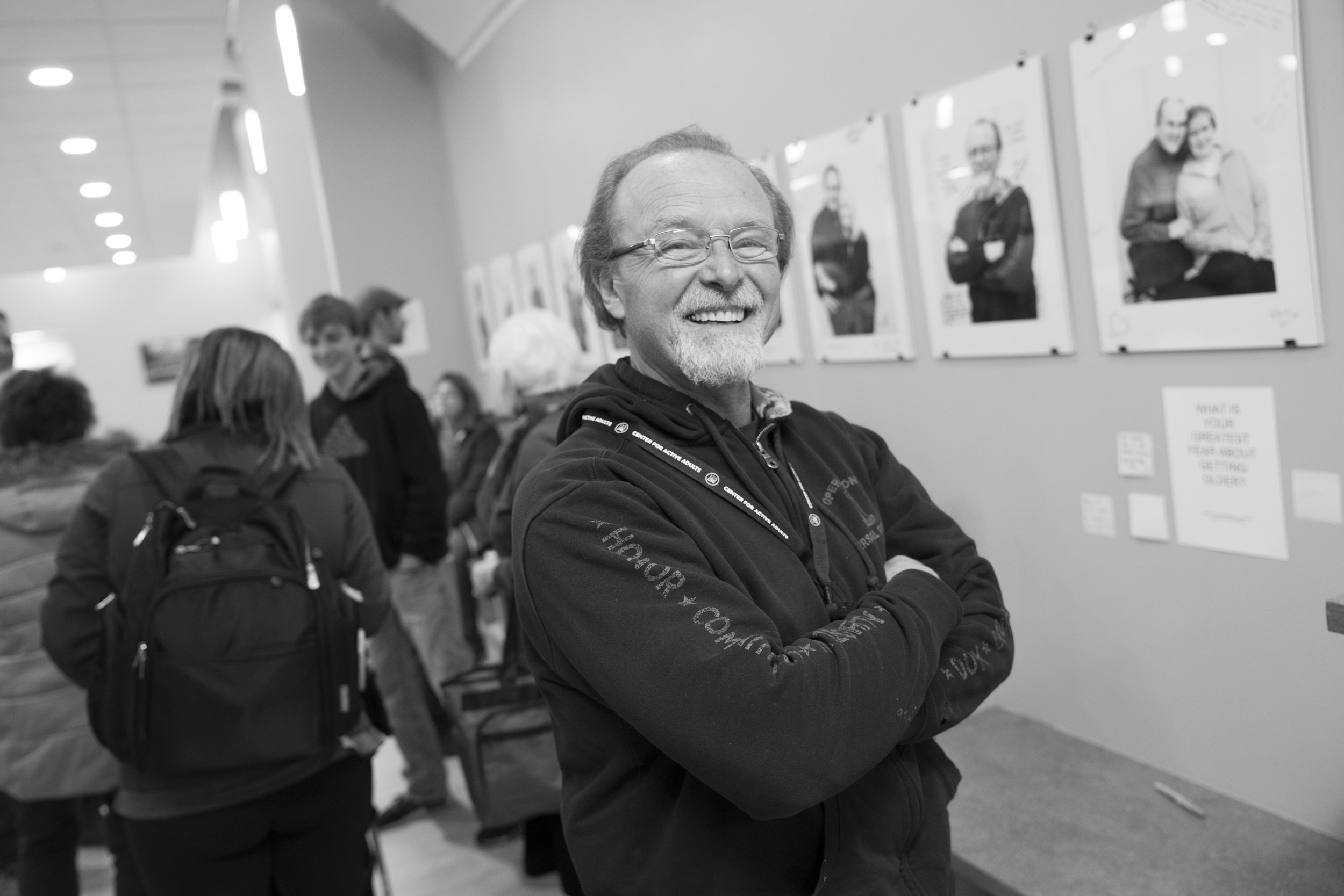 A Racing Age workshop participant and his art, during the exhibit opening at 125 LIVE in Rochester, MN.