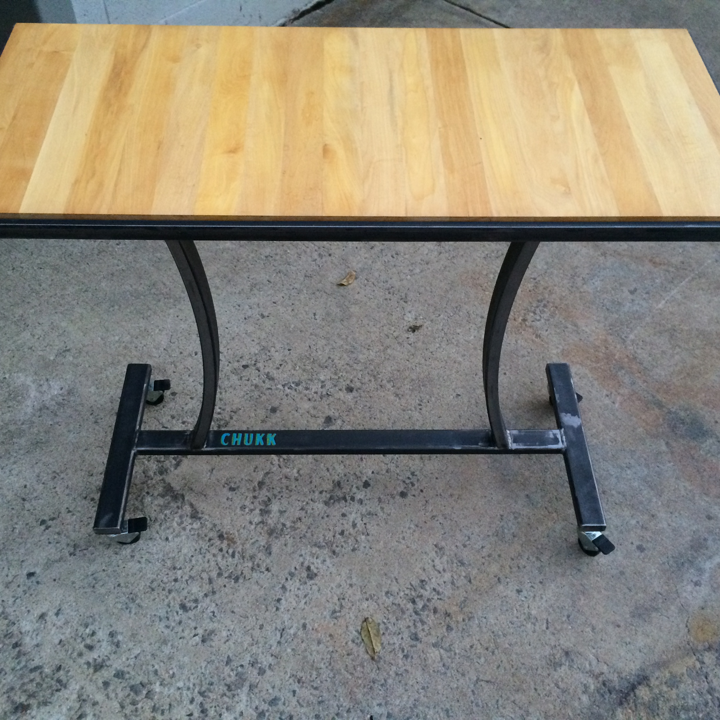 Steel roll about table