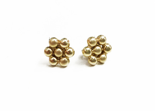 Gold earrings from Venezuela, because my abuelita loves me.