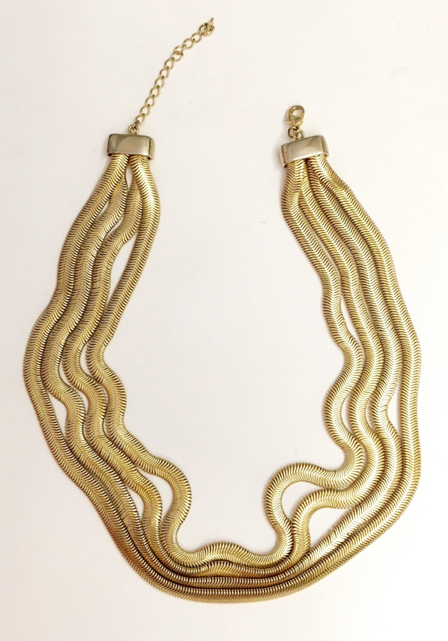 Brass snake necklace from that mecca Housing Works.