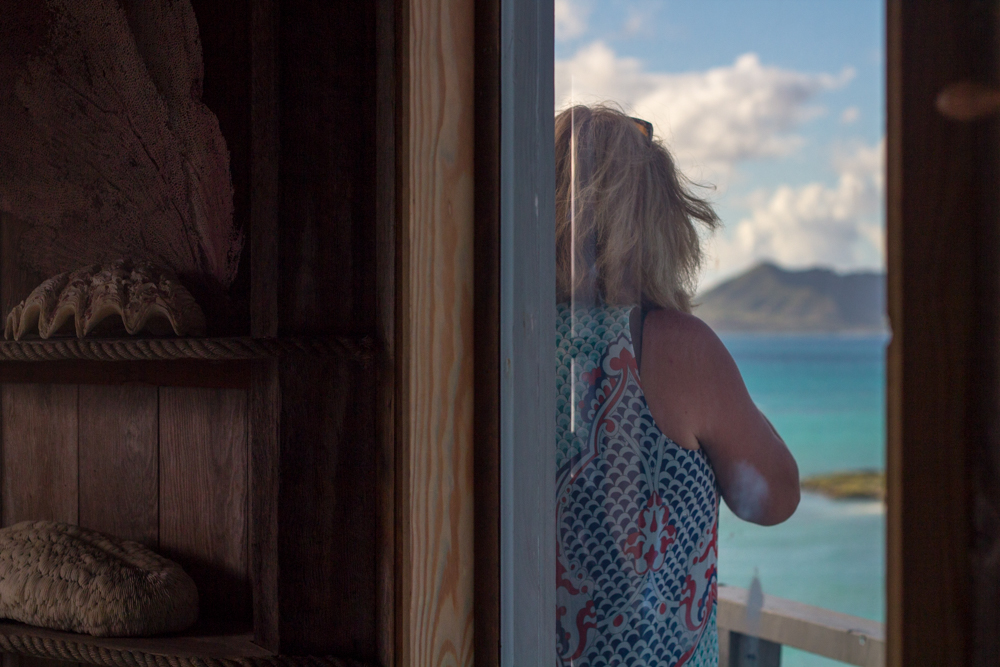 woman-hilltop-rock-house-lanikai.jpg