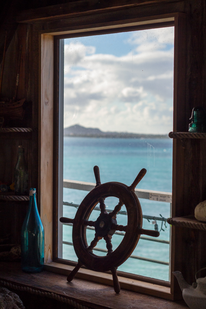 lanikai-hilltop-rock-house-ship-wheel.jpg