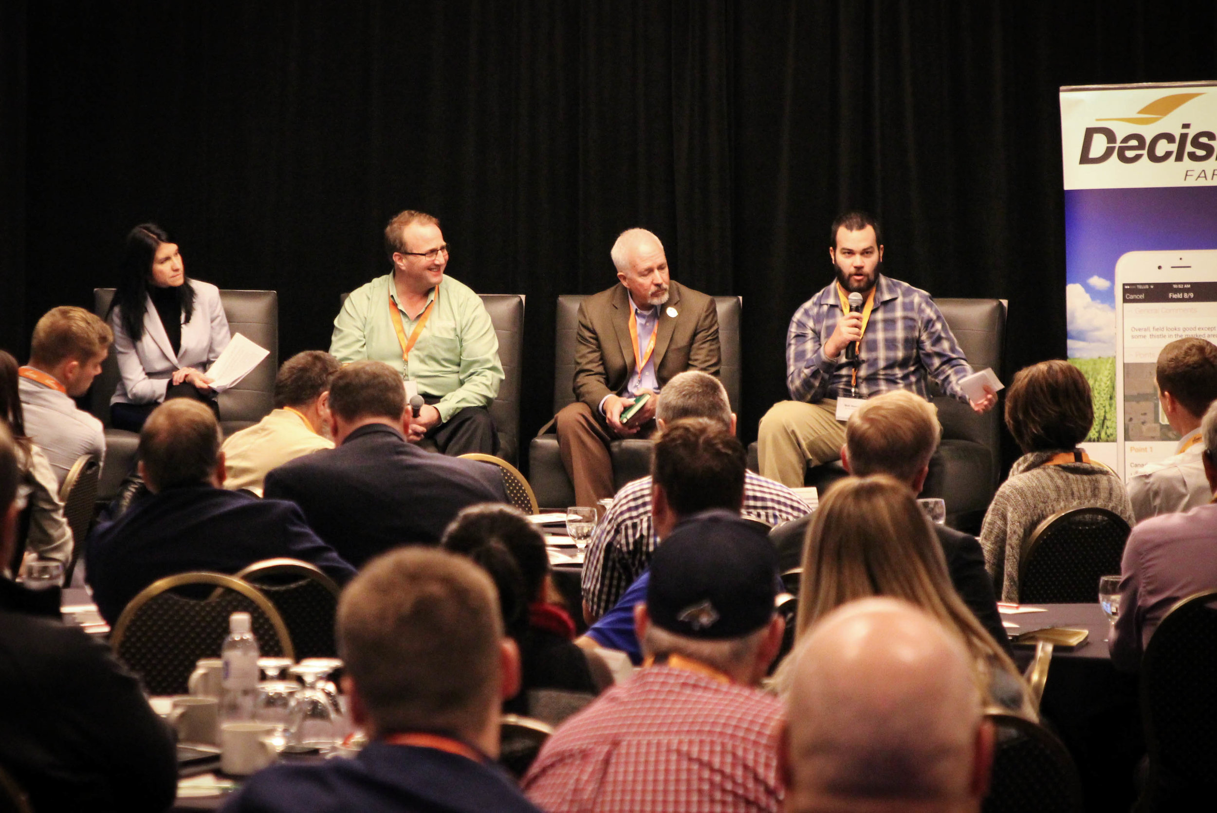Trish Meyers from Federated Co-operatives Limited moderating a panel with Earl Greenhough, Koch Fertilizer; Mike O'Dea, INTL FCStone; and Matt Hamill, Red Shed Malting.