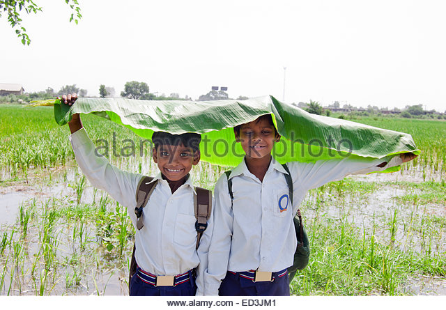 Obligatory stock photo of Indian school kids during the rainy season. Obviously not my own photo.