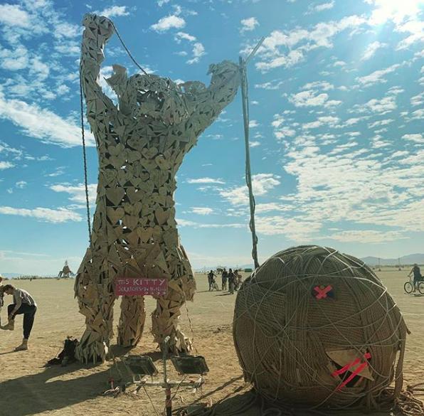 Giant kitty art made of hearts.