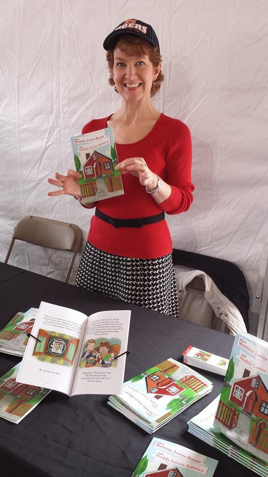 Book signing with Auburn hat and a houndstooth skirt! Roll Eagle War Tide, y'all!