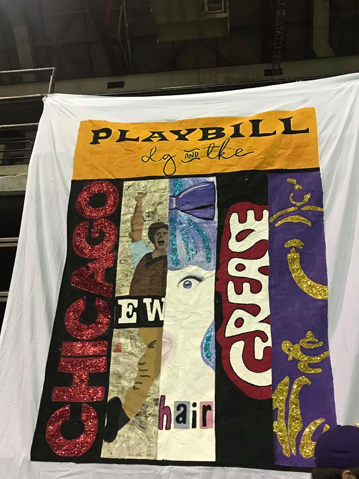 [Photo description: DG's Songfest banner painted to look like a playbill using snippets from Broadway posters.]