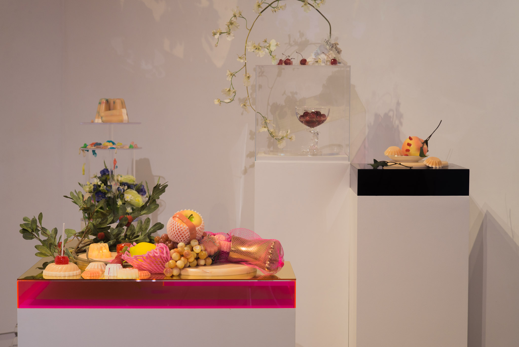 Installation view with  Low Hanging Fruit, Garden, Fountain of Dreams,  and  Peach's Peaches,  2017. Mixed media; dimensions variable. Photographed by Tamara Legér.