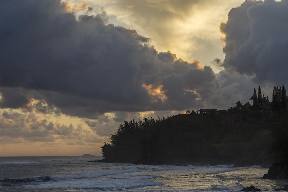 Sunrise as seen from the cliffs near Queen's Bath, Princeville, Kaua'i.