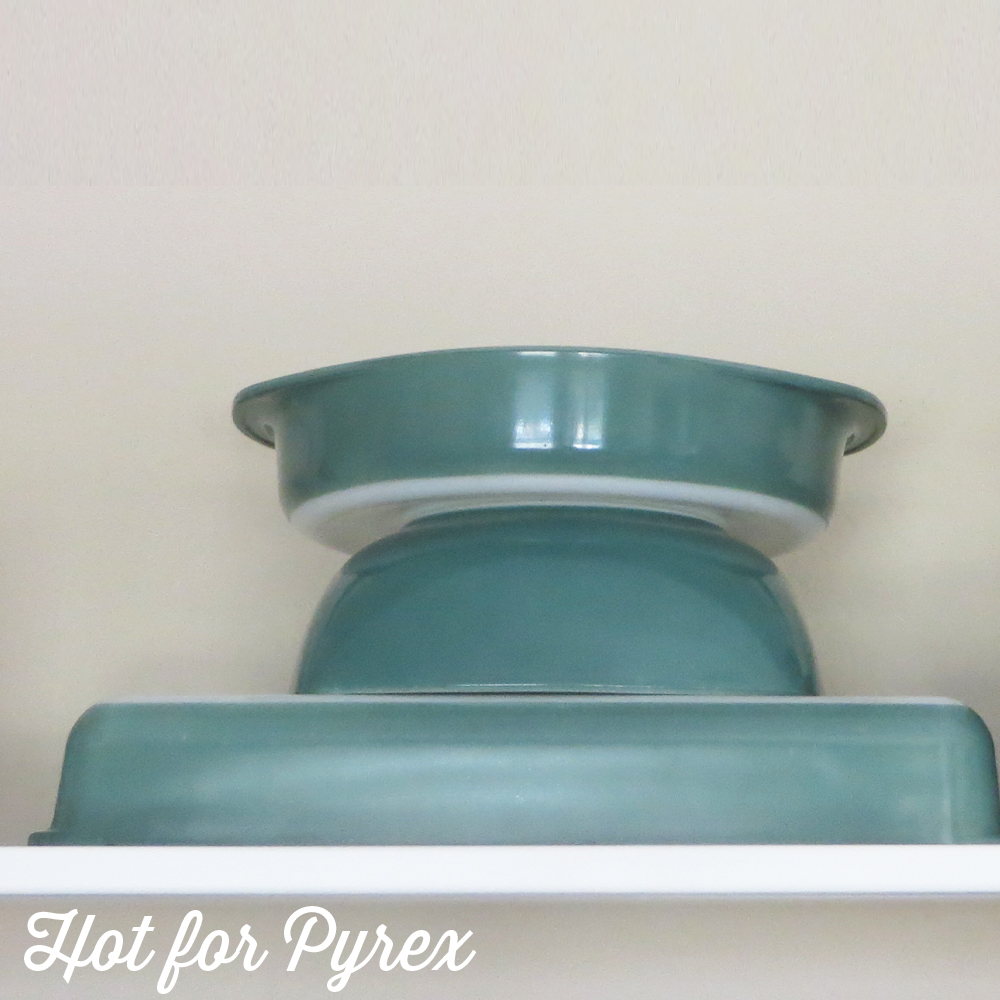 The list of vintage Pyrex made in the Regency/Heinz green color continues to grow.  Most recently discovered is the 232 Utility Baking dish.  While no official paperwork has been uncovered, one theory is that this bakeware series was produced to complement the Regency tableware pattern released in the 1950s.  This shade of green is also found on the Heinz promotional dish, so it is unclear what the official name of this color should be.  Whatever the name, this series includes 015 + 025 Hostess Bowls (015 with clear glass lid, 025 with solid lid), 024 round casserole, 221 cake pan, 232 utility dish, and unmarked mini bowls.  One shape that has not surfaced yet, but would fit into the bakeware line, is the standard 209 pie plate.  Since new pieces in this color keep popping up, there is no telling how many more shapes and sizes were produced in this color!  Kind of exciting, right?