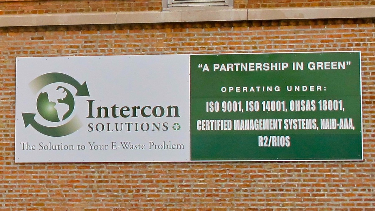 Close-up of Intercon Solutions' sign touting their Certifications. 2014. Copyright BAN.