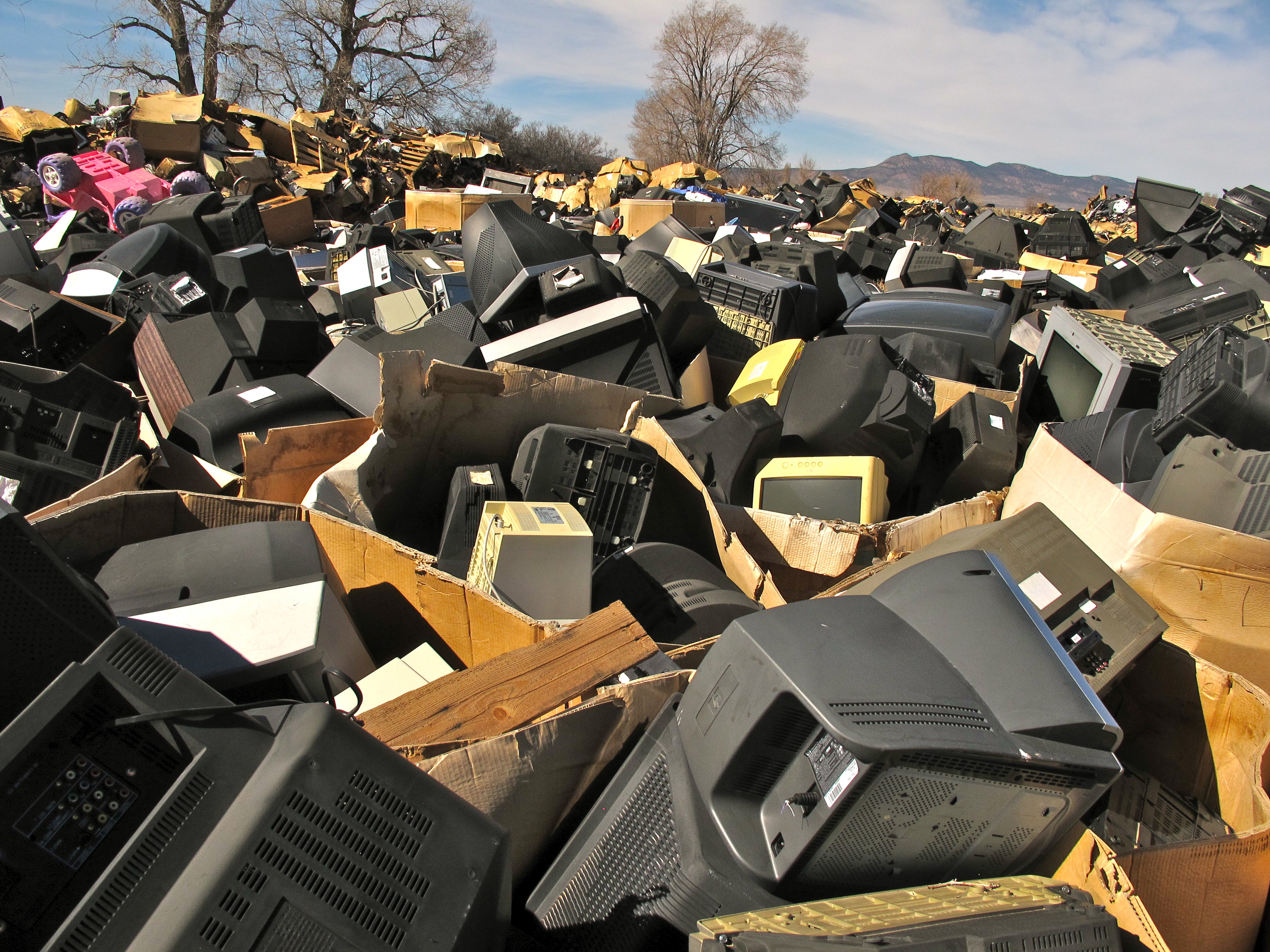 Gaylord boxes of old TVs dumped by Stone Castle LLC, in Parowan, Utah. Copyright BAN 2014.