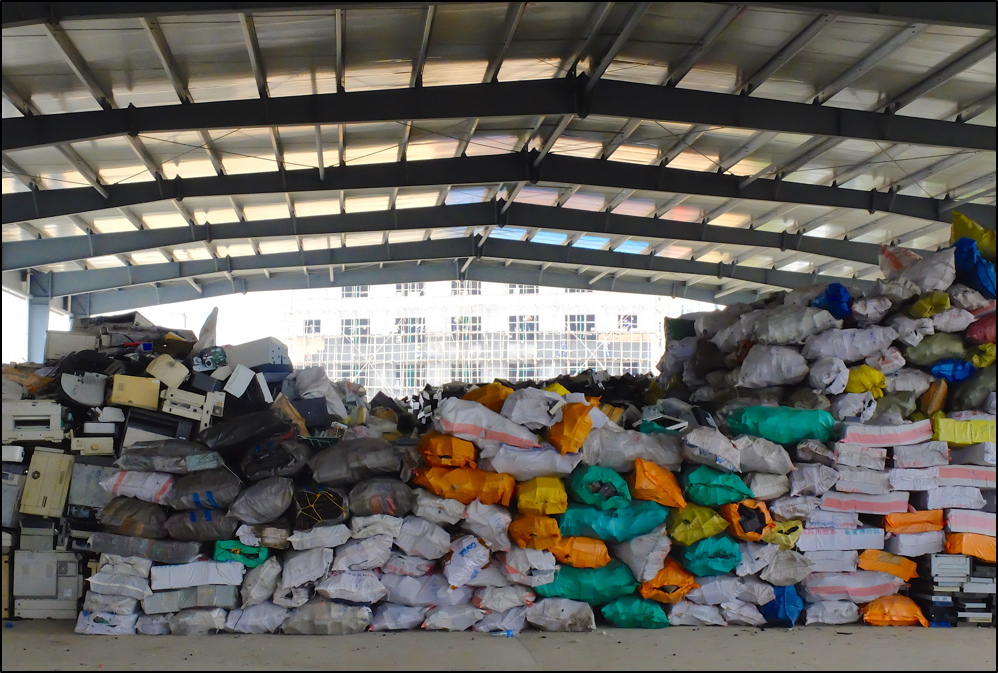 Waste piled high at truck receiving center, Industrial Park, Guiyu. Copyright BAN 2015.