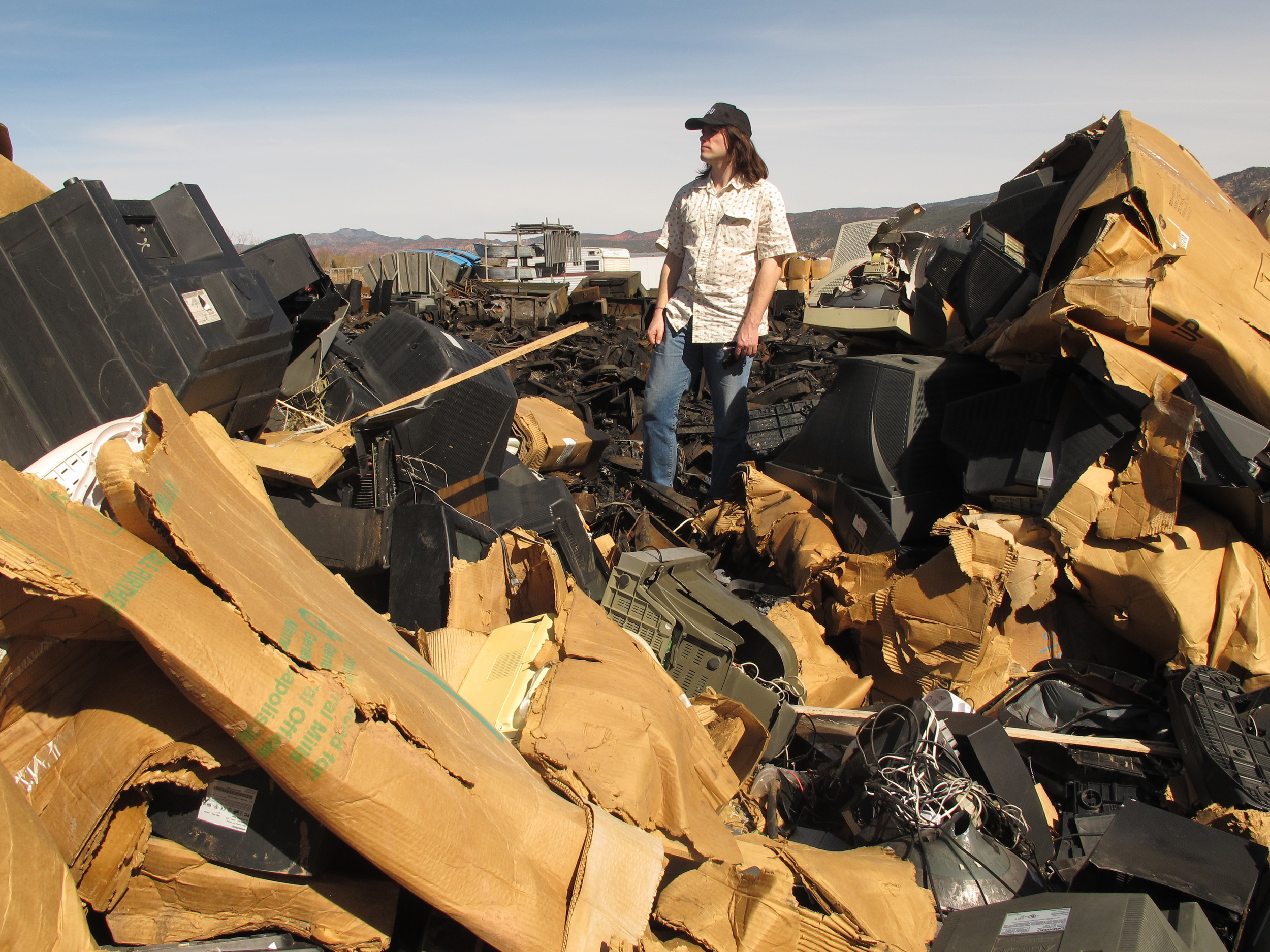 BAN's researcher scans the TV wasteland at Stone Castle Recycling, Parowan, Utah. Copyright BAN 2014.