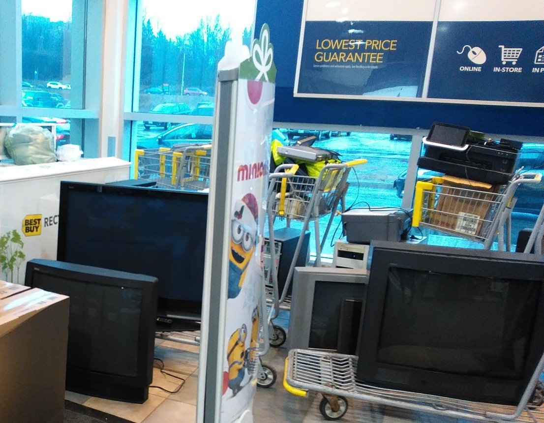 Old electronics dropped off by Best Buy customers await recycling. December 2015.