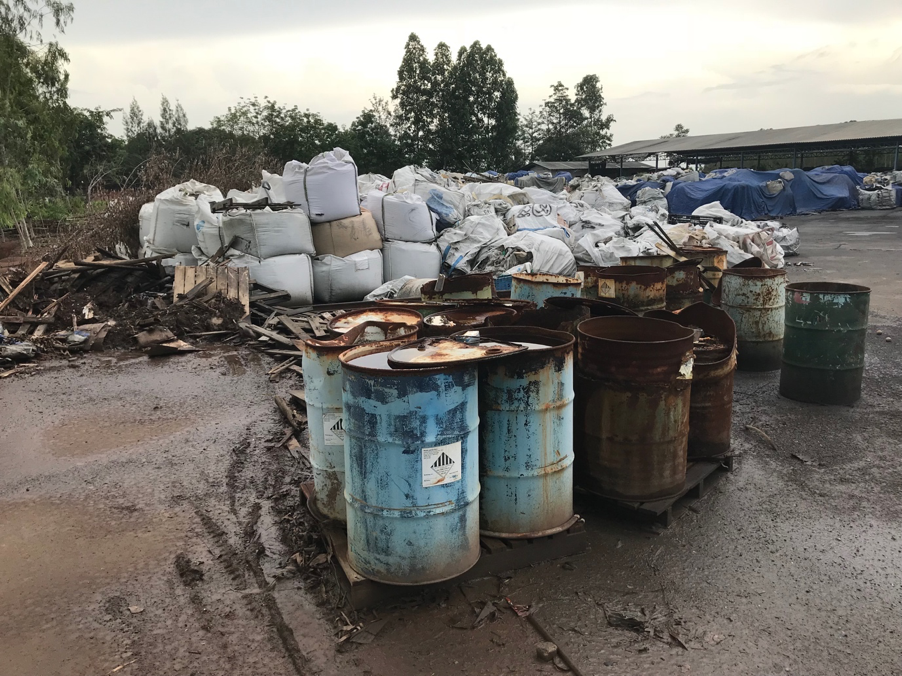 Bags of imported e-waste, and barrels of chemicals used to crudely process it found at hidden Thai facility located by BAN's GPS tracked device delivered to Officeworks store in Brisbane. Copyright Basel Action Network, July 2018.