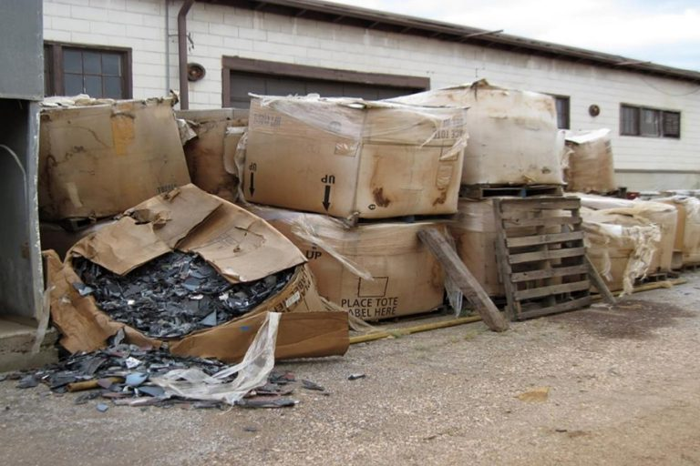 A photo from court records shows CRT glass stored outside Stone Castle Recycling's Clearfield, Utah facility.