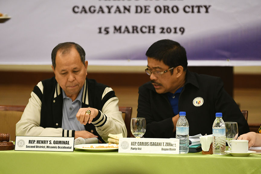 Rep. Henry Oaminal (2nd District, Misamis Occidental), chair of the House Committee on Good Governance and Public Accountability, and Bayan Muna partylist Rep. Carlos Isagani Zarate consult each other during the public hearing in Cagayan de Oro City on Friday (15 March 2019) on the South Korean garbage mess). MindaNews photo by FROILAN GALLARDO