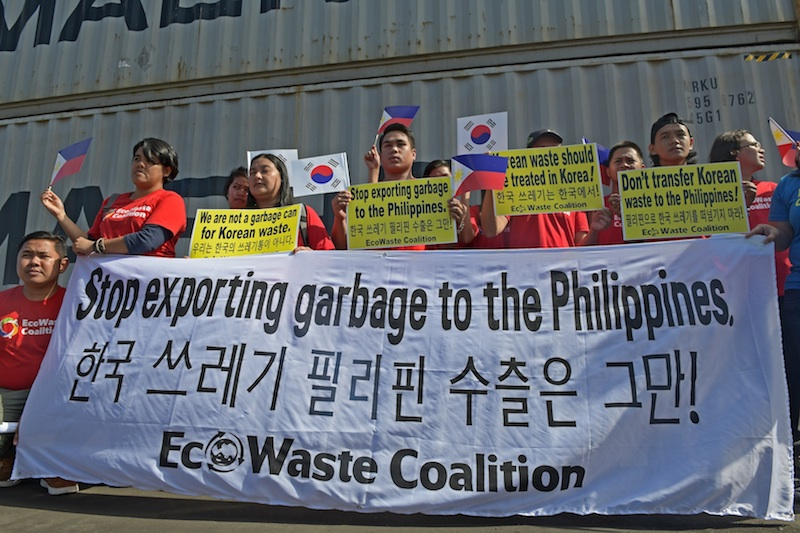 Activists from the Ecowaste Coalition, an environmental NGO, stage a rally at the Mindanao Container Terminal in Tagoloan, Misamis Oriental on Sunday, 13 January 2019, where 51 container vans containing 1,400 tons (1.27 million kilos) of garbage are being shipped back toPyeongtaek, South Korea their port of origin. But 5,100 tons of waste still remain in Tagoloan, awaiting shipment back to South Korea. MindaNews photo by FROILAN GALLARDO