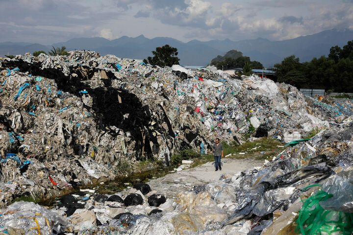 A Greenpeace activist at a dumpsite in Ipoh, Malaysia, on Jan. 30. Unlicensed recyclers are illegally burning or dumping waste plastics at sites across the country.
