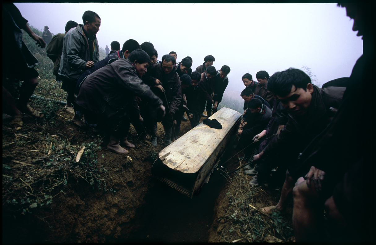 Villagers burying the body.