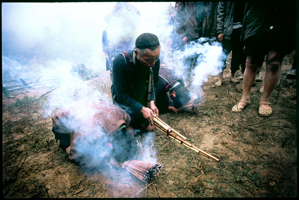 Playing an native instrument 'Kheng' (bamboo mouth organ)