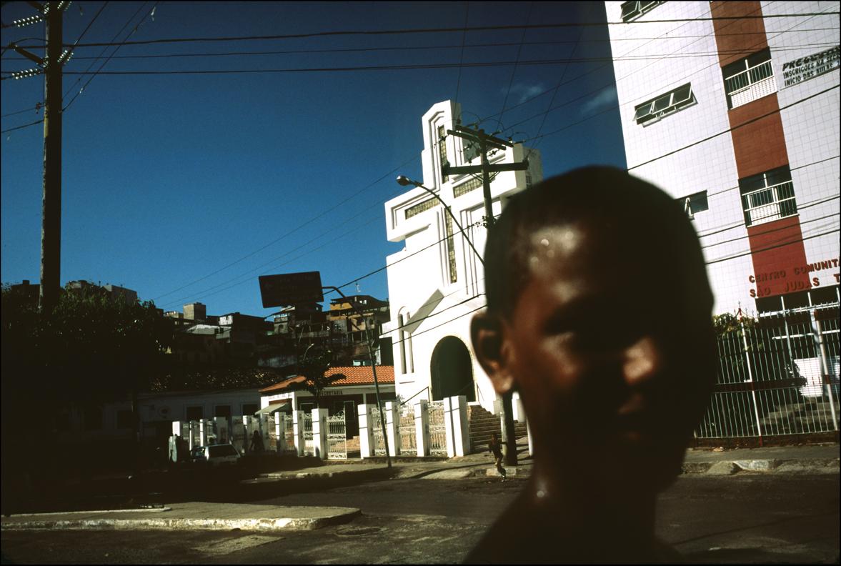 Boy in front of church. Brasil.