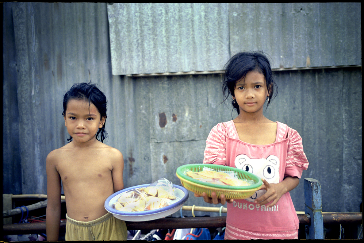 Local kids selling trinkets, Mekong Delta.