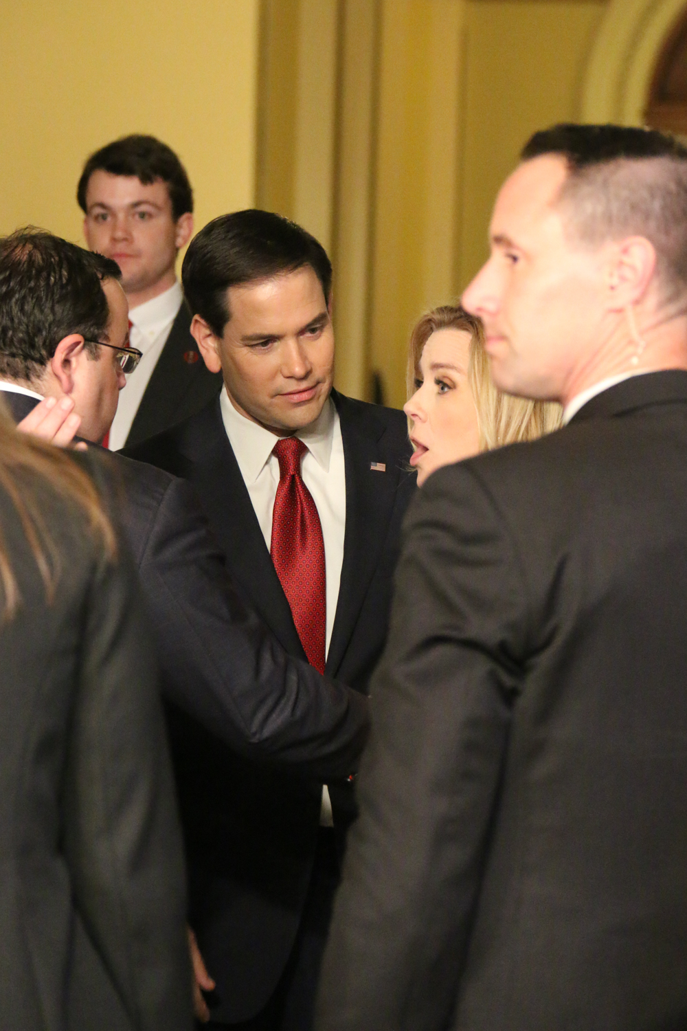 Sen. Marco Rubio, R-Fla., speaks with reporters in Statuary Hall. Later, he posed for pictures with senators and representatives and their invited guests.