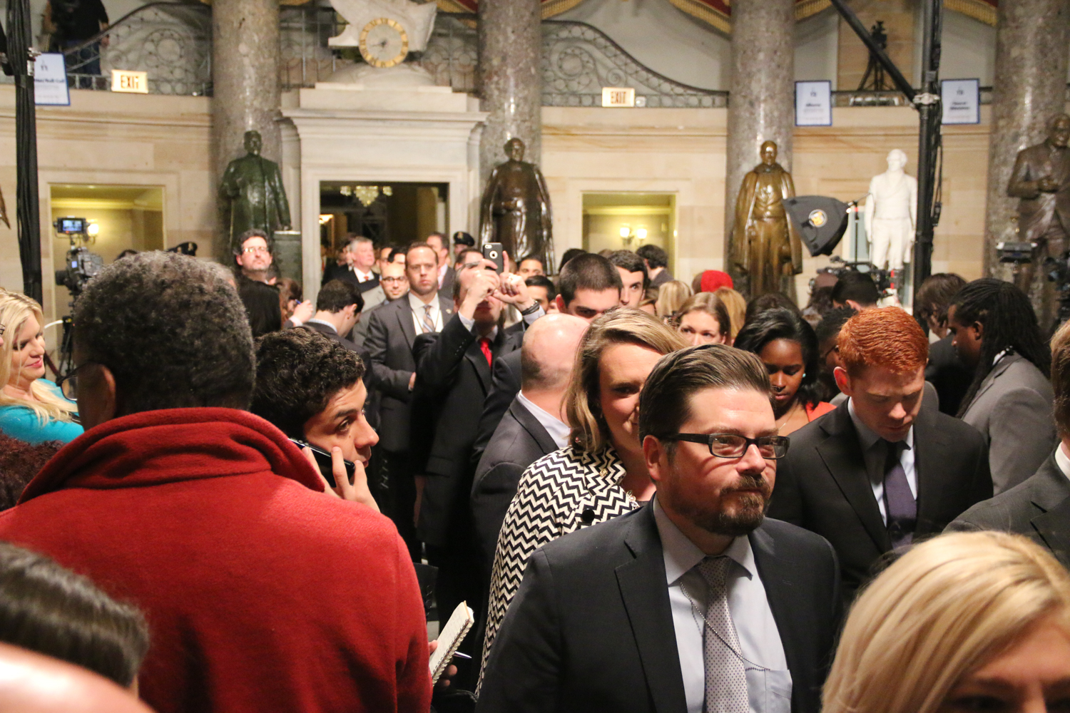 The remaining members of Congress and their staff line up in Statuary Hall while they wait to enter the House Chamber.