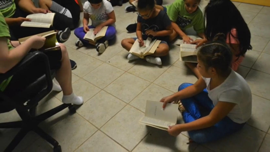This was the lesson where I got to teach the kids how to look up Bible verses. This is one of the most precious pictures to me because everyone was so excited and interested to read.