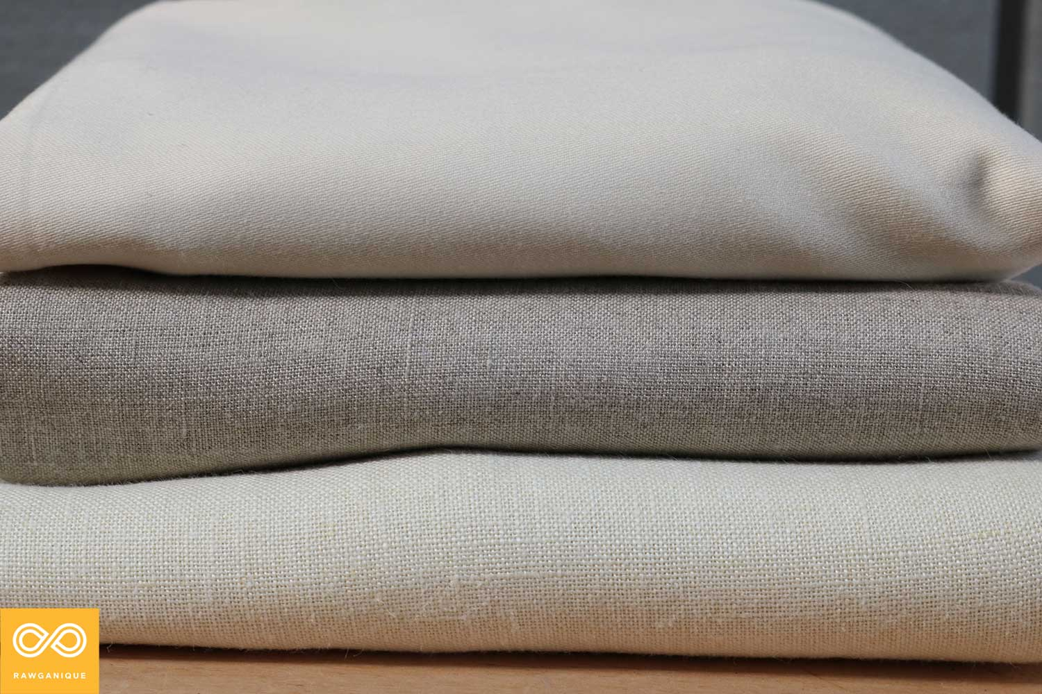 Organic sateen cotton (top), organic linen (middle), and organic hemp (bottom) bed sheets.