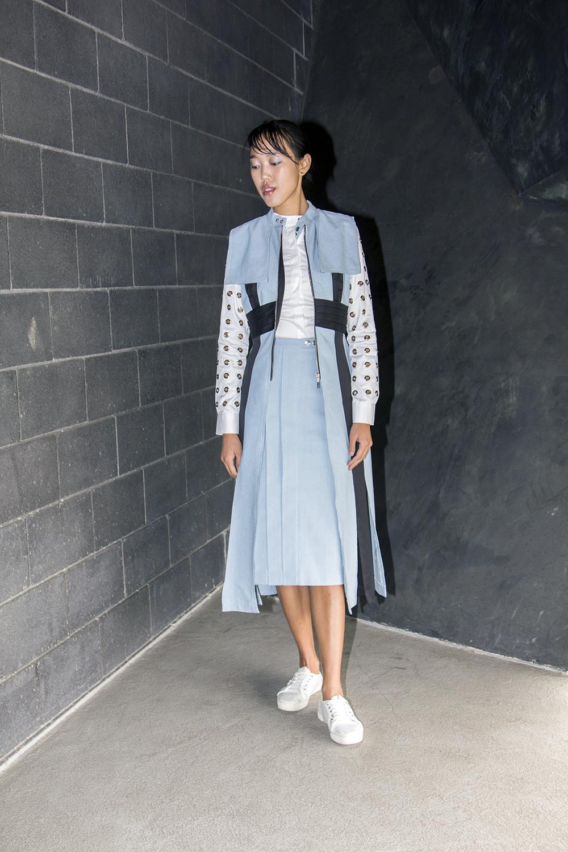 The  Edie  sleeveless jacket,  Titan  shirt, and  Tunnel  skirt.