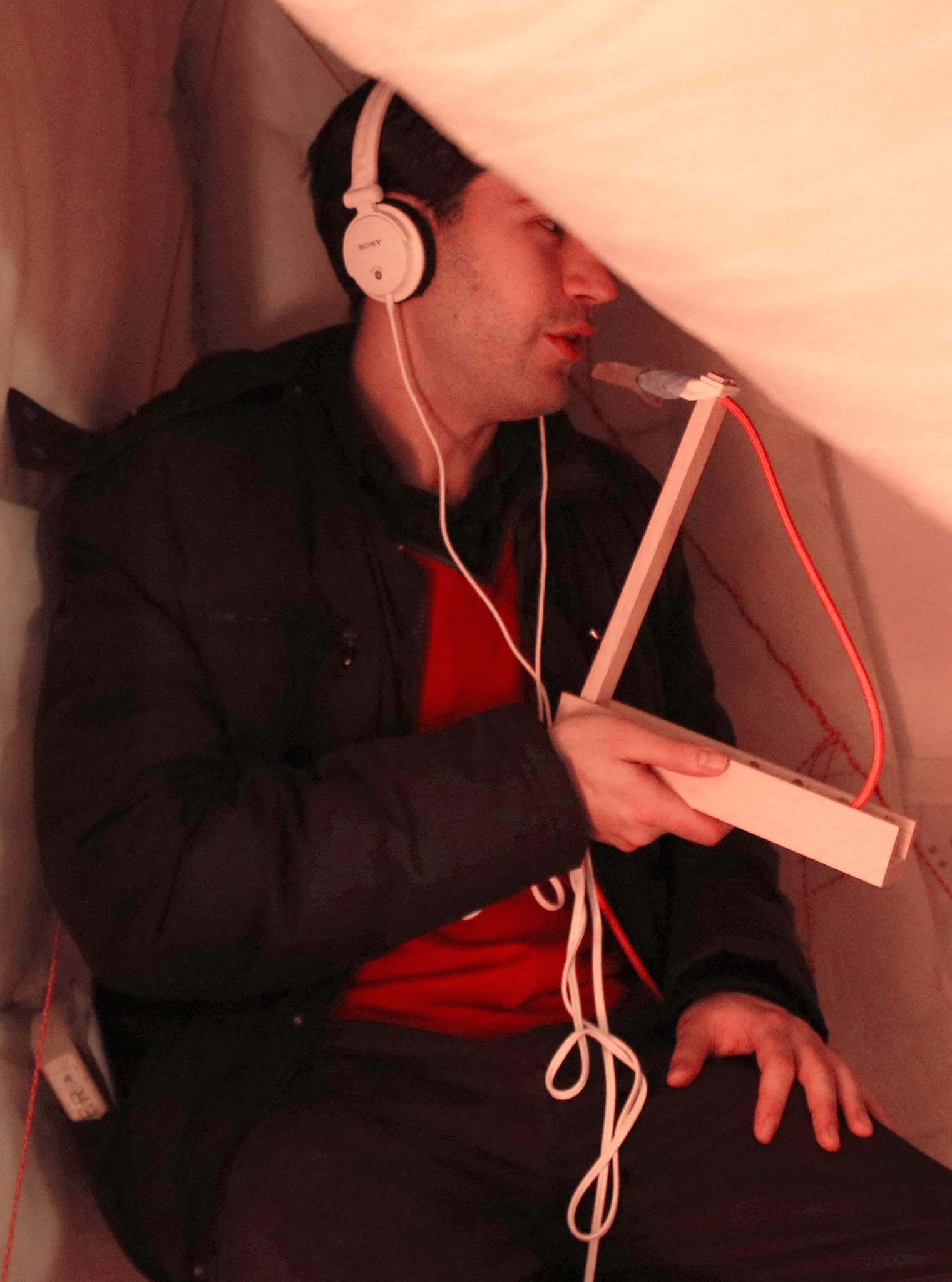A guest trying the taste of music in our cocoon with sound-isolating headphones for an immersive experience
