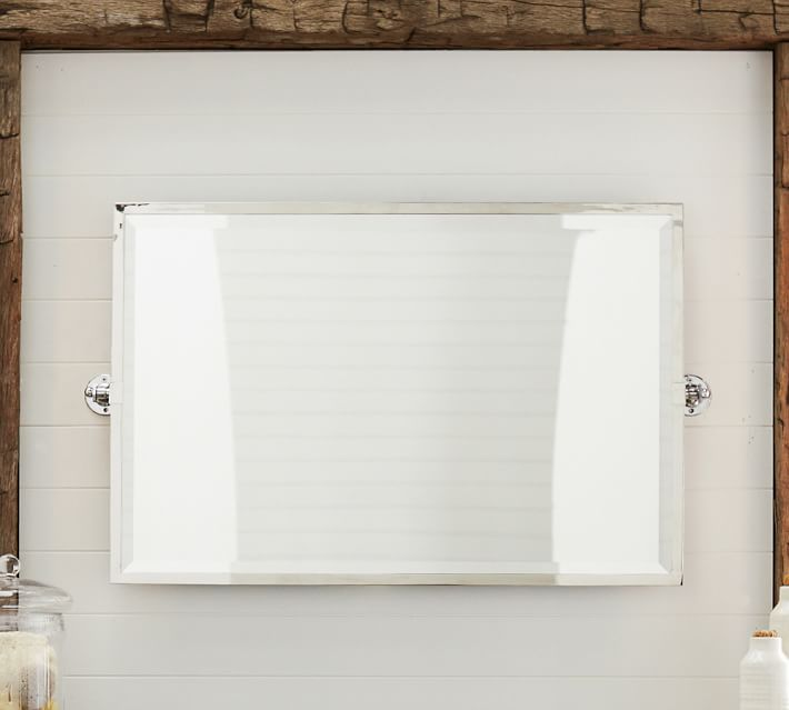 Click to shop the Kensington Pivot Wide Rectangle Mirror at PotteryBarn.com