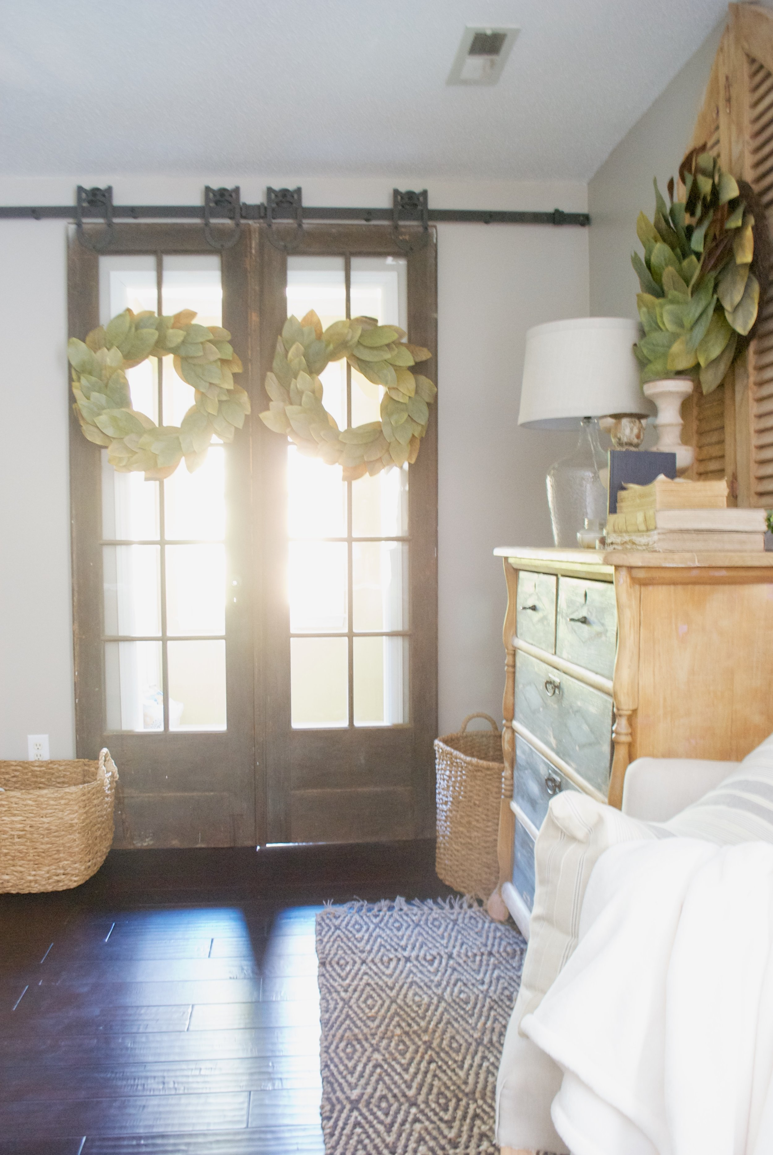Plum Pretty Decor and Design Farmhouse Master Bedroom Tour- French Doors and Magnolia Wreaths