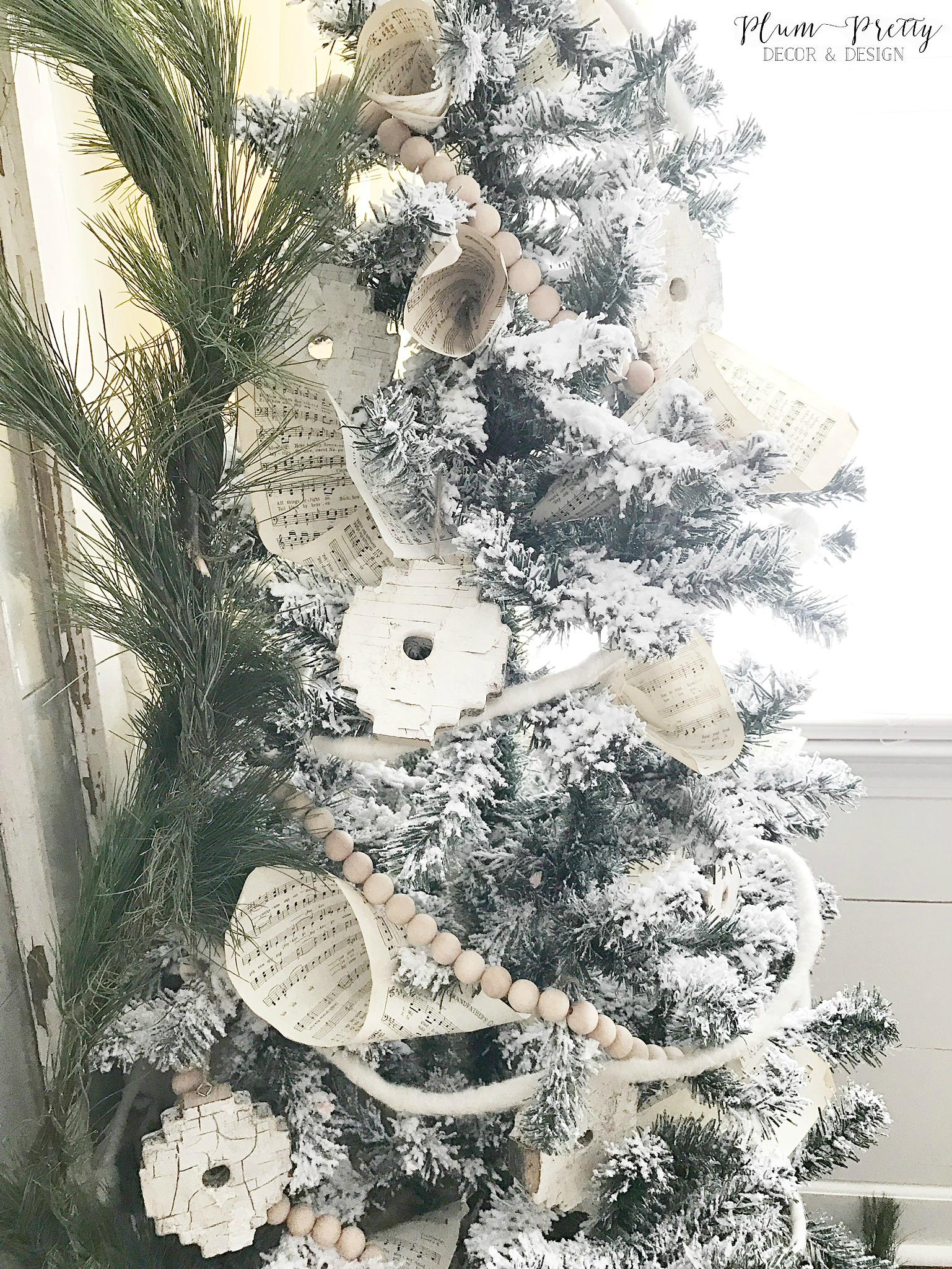 Flocked Christmas Tree with Chippy Architectural Ornaments and Music Sheets- Plum Pretty Decor and Design
