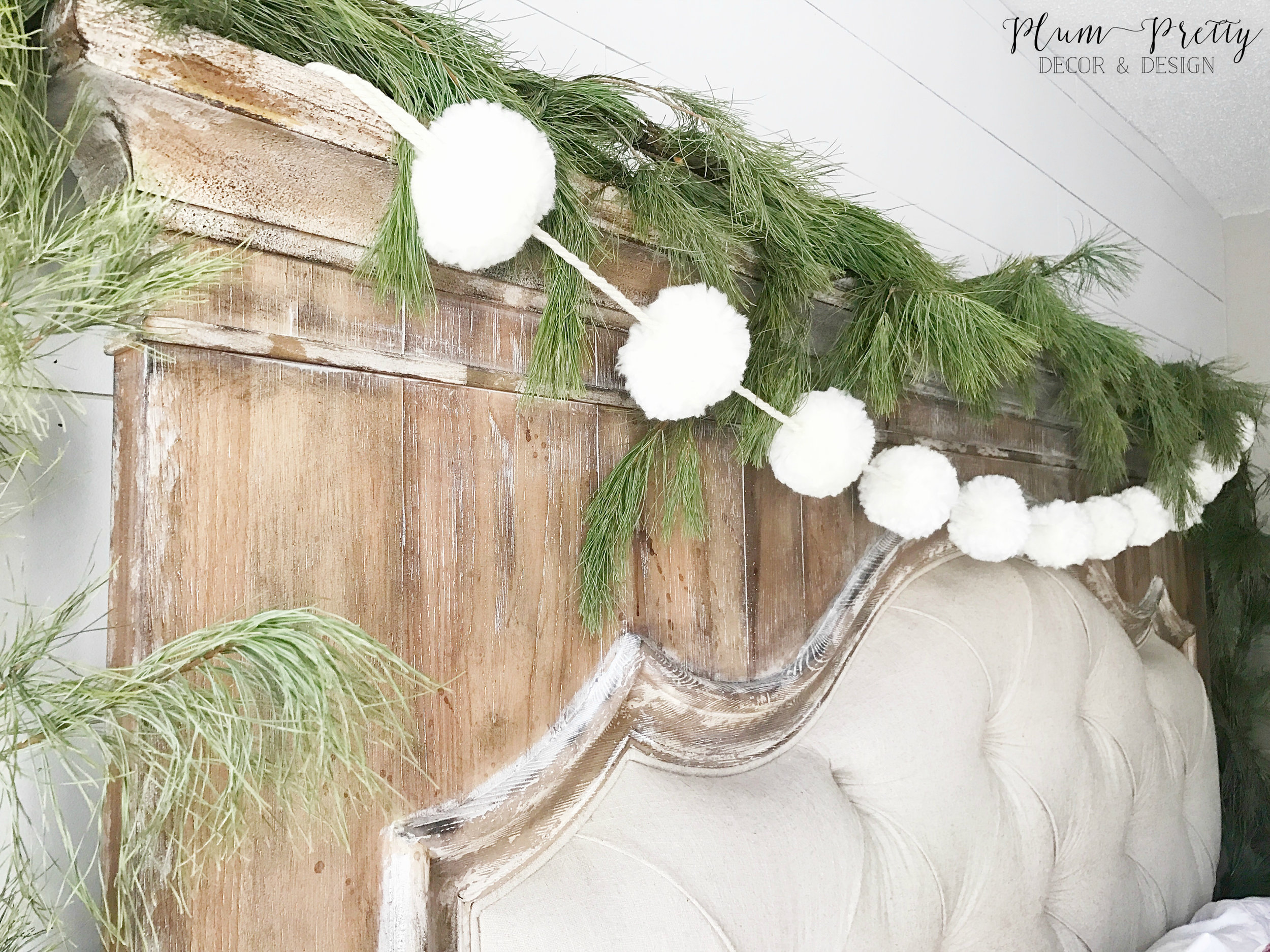 Farmhouse Christmas Bedroom- Tufted Headboard with Pom-pom Garland by Kayla Miller of Plum Pretty Decor and Design