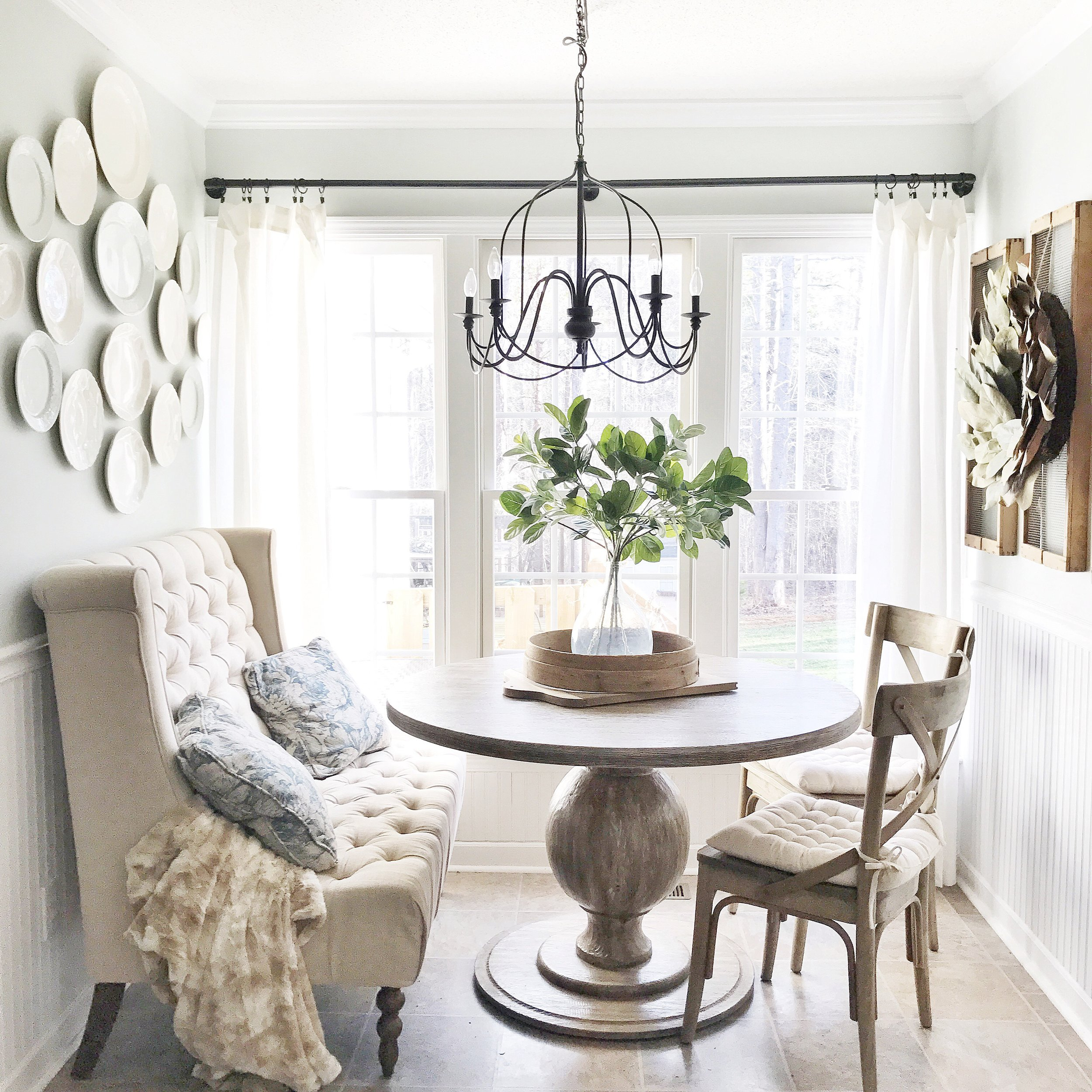 Farmshouse Breakfast Nook with a French Flair- How Adding Linen Curtains Really Cozied Up the Space. Read More on Plum Pretty Decor and Design's Blog.
